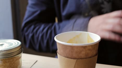 Man-Drinking-a-Cup-of-Coffee