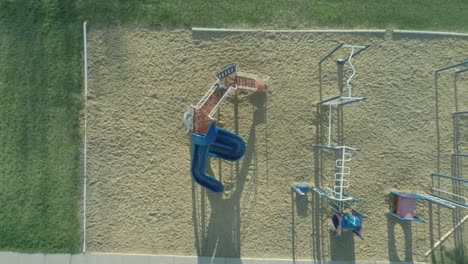 Aerial-Child-Going-Down-Slide