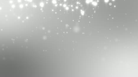 White-Sparkles-Against-Silver-Background-Loop