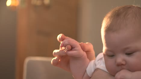 Mother-Holding-Babys-Hand-01