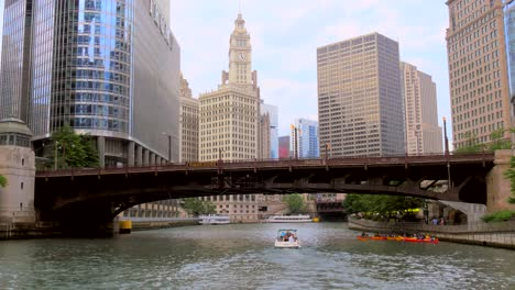 Boat-Passing-Under-Bridge-on-Chicago-river
