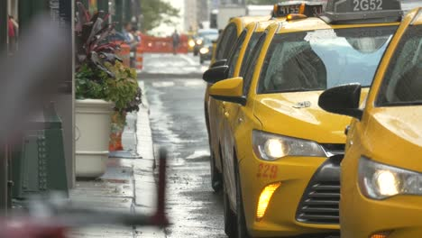 Close-Up-of-Wet-Taxis-in-New-York