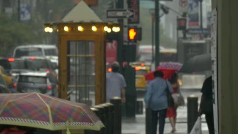 People-Walking-Through-Rain-Under-Umbrellas