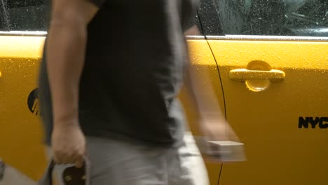 Man-Getting-out-of-Taxi-in-New-York
