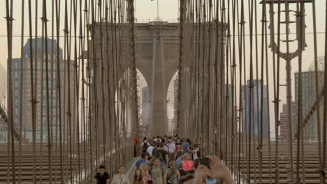A-Crowd-of-People-Walking-Across-Brooklyn-Bridge