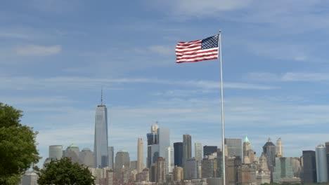 USA-Flag-Flying-infront-of-New-York-Skyline