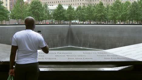 Man-Looking-Over-911-Memorial-New-York