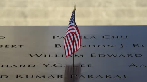 Close-Up-of-USA-Flag-Flying-in-911-Memorial-Plaque