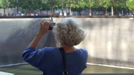 Lady-Photographing-the-911-Memorial-New-York