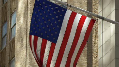Close-Up-of-USA-Flag-Flying-on-Wall-Street