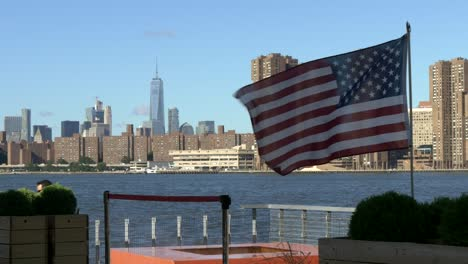Manhattan-Skyline-with-American-Flag