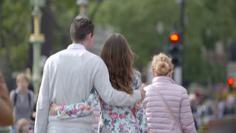 Couple-Walking-along-Westminster-Bridge