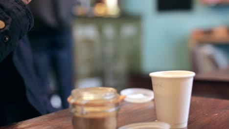 Man-Drinking-Coffee-in-Coffee-Shop