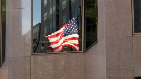 Reflection-of-USA-Flag-Flying-in-a-Window