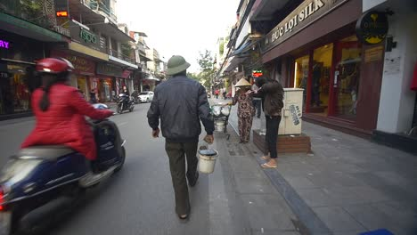 Man-Walking-with-Bucket-down-Vietnamese-Street