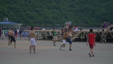 Men-Playing-Soccer-in-Street-1