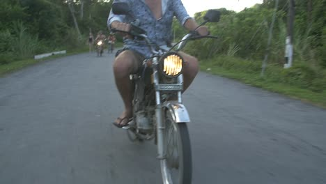 Man-Riding-a-Scooter-Through-Vietnamese-Countryside