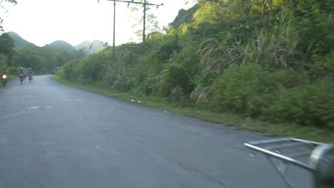 Man-Riding-a-Motorbike-Through-Vietnamese-Countryside