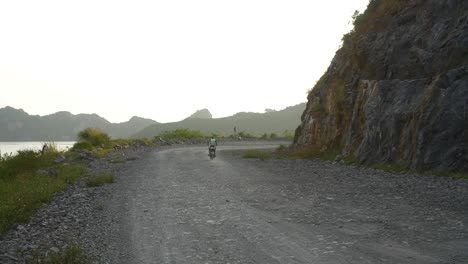 Motorbike-Driving-Along-Vietnamese-Dirt-Road