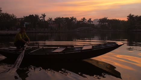 Lady-on-a-Traditional-Vietnamese-Boat-at-Sunset