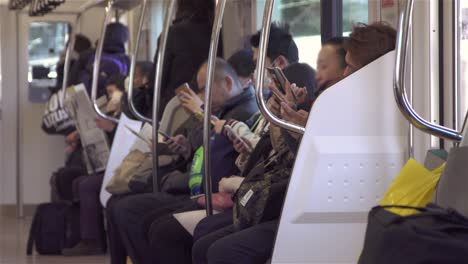 Commuters-Using-Smartphones-on-Train