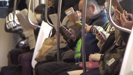 Commuters-Using-Smart-phones