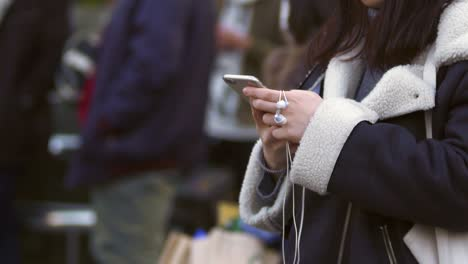 Young-Woman-Using-Smart-Phone