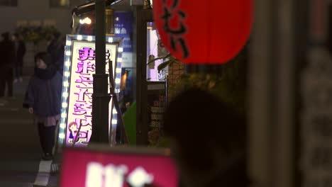 Illuminated-Signs-on-Tokyo-Sidewalk
