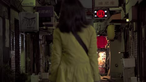 People-Walking-Down-Dark-Tokyo-Alleyway
