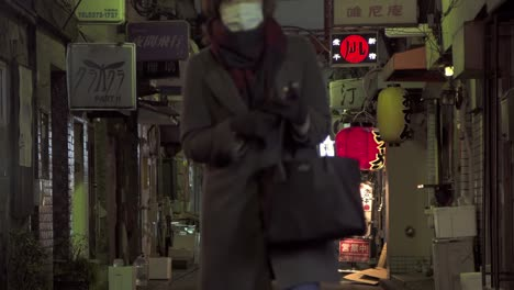 Lady-Walking-Down-Dark-Japanese-Street