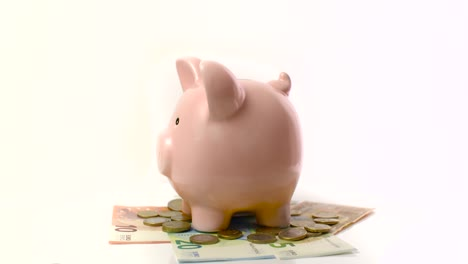 Piggy-Bank-Rotating-on-Euros