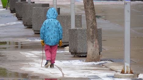Child-Walking-Along-Snowy-Path