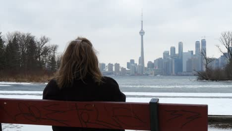 Woman-Overlooking-Toronto-Skyline
