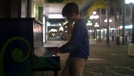 Young-Boy-Playing-Piano-in-the-Street