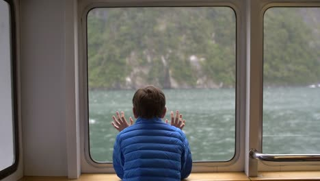 Young-Boy-Looking-Out-of-a-Ship-Window-2