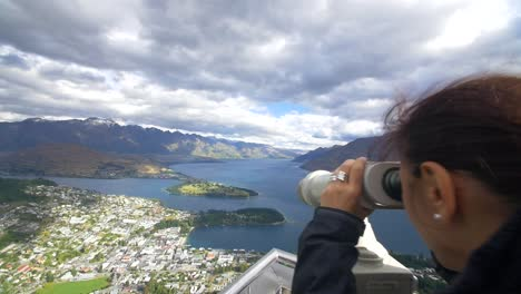 Woman-Looking-Through-Binoculars