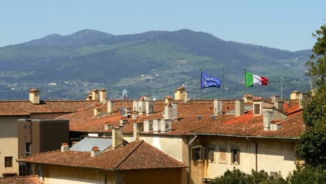 EU-and-Italian-Flag-Flying-in-Florence