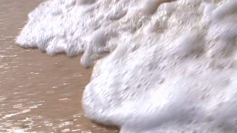 Slow-Motion-Waves-Breaking-on-Sand-2