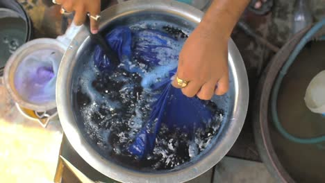 Man-Hand-Dyeing-Clothes-Blue