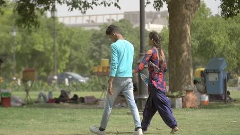 Couple-walking-through-a-Park
