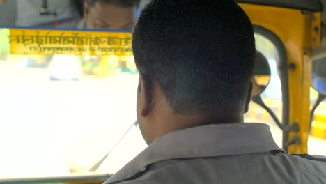 Handheld-Shot-of-a-Tuk-Tuk-Driver