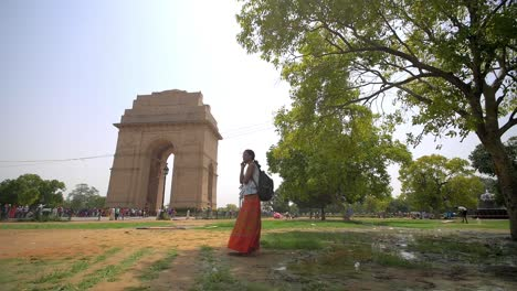 Woman-Using-Phone-at-India-Gate