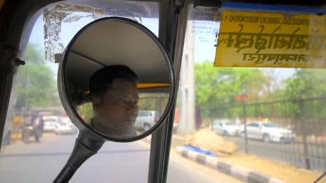 Tuk-Tuk-Drivers-Reflection-in-Wing-Mirror