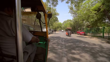 Indian-Tuk-Tuk-Driving-Along-Side-Road
