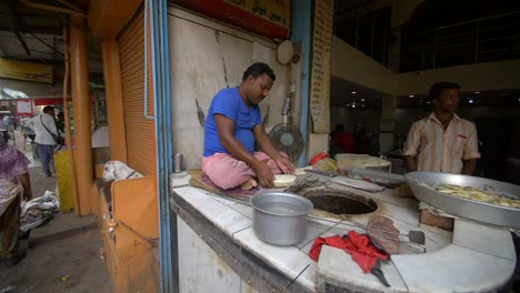 Indian-Man-Cooks-Naan-in-a-Bread-Oven