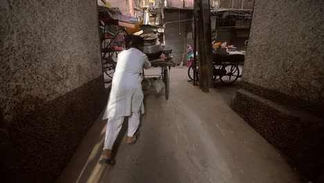 Indian-Man-Pushing-Cart-Down-Alleyway