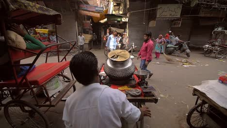 Man-Pushing-Cart-onto-Busy-Indian-Road