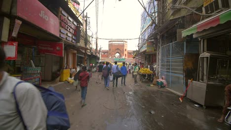 People-Walk-Down-a-Road-Towards-Jama-Masjid