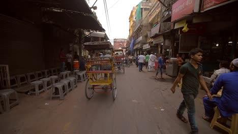 A-Man-Steers-a-Rickshaw-Down-a-Delhi-Street