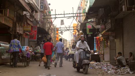 People-Walking-Down-a-Road-in-India